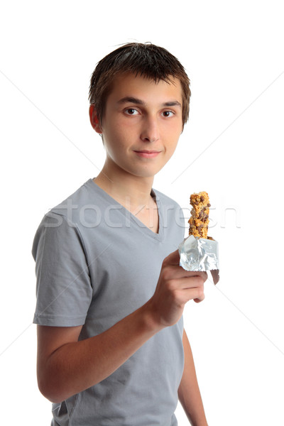 Boy holding a nutritional snack bar Stock photo © lovleah