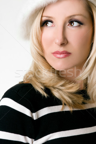 Wide eyed woman looking over shoulder Stock photo © lovleah