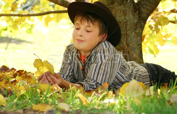 Child holding autumn leaves Stock photo © lovleah
