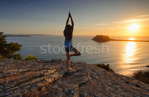 Yoga by the Sea at sunrise - Tree Pose Vrksasana Stock photo © lovleah