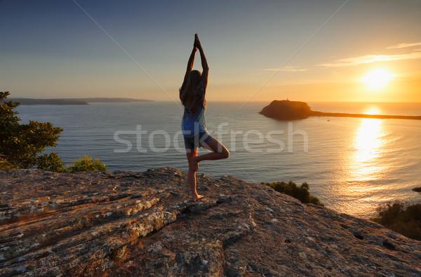 Yoga by the Sea at sunrise - Tree Pose Vrksasana Stock photo © lovleah