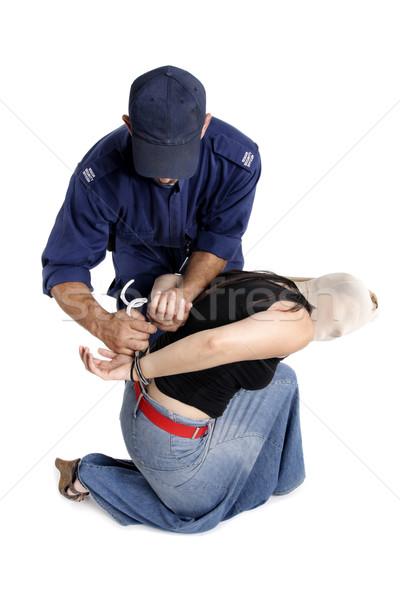 Przestępca bezpieczeństwa oficer kajdanki przestępcy ręce Zdjęcia stock © lovleah
