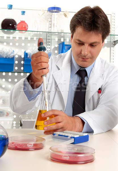 Scientist taking sample with pipette Stock photo © lovleah