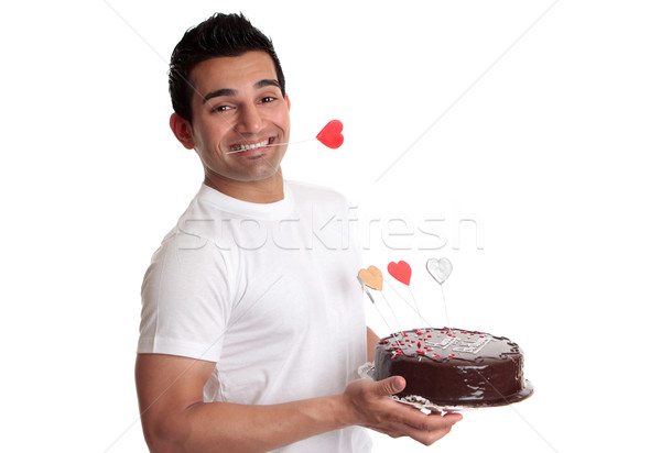Man holding delicious chocolate cake decorated with love hearts Stock photo © lovleah