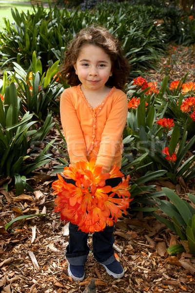 Beautiful little girll with a bunch of clivia from the garden Stock photo © lovleah