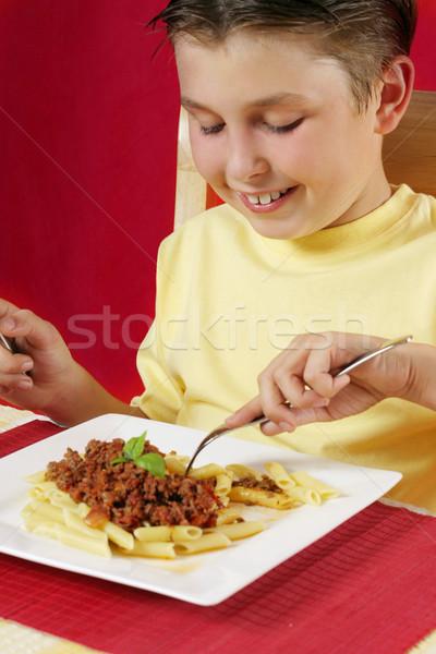 Stockfoto: Kind · eten · smakelijk · pasta · maaltijd · gelukkig