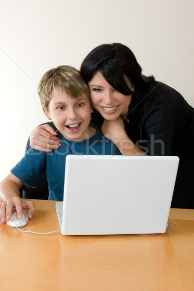 Adult and child enjoying computer time Stock photo © lovleah