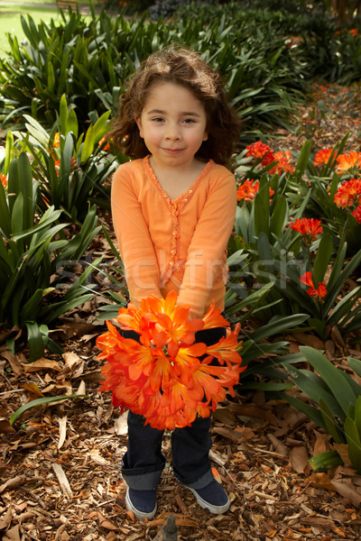 Girll with a bunch of clivia from the garden Stock photo © lovleah