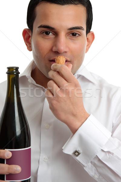 Man or wine steward sniffing wine cork Stock photo © lovleah