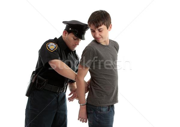 Politieagent tiener politieagent handboeien jonge mannelijke Stockfoto © lovleah