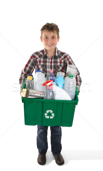Boy holding recycling bin full or rubbish Stock photo © lovleah