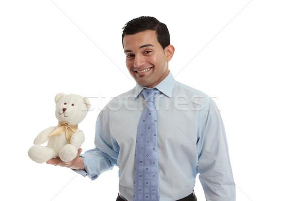 Man holding a knitted teddy bear Stock photo © lovleah