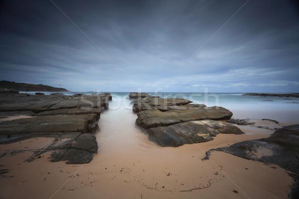 Viharos tengerpart természetes kő csatorna katonák Stock fotó © lovleah