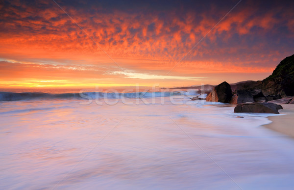 Dramatic red skies and frothy white waves beaches Stock photo © lovleah