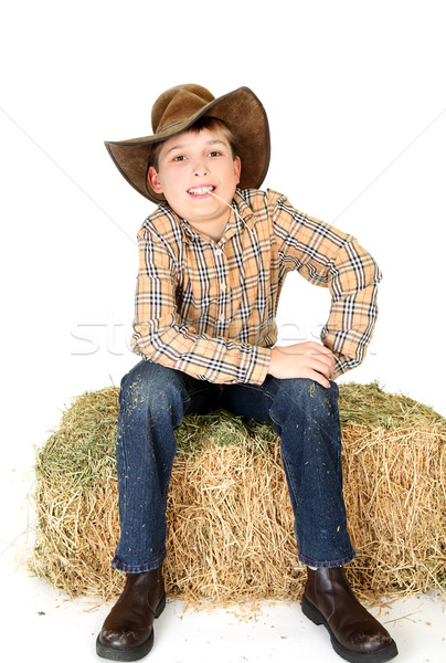 Farm boy chewing on a piece of straw Stock photo © lovleah