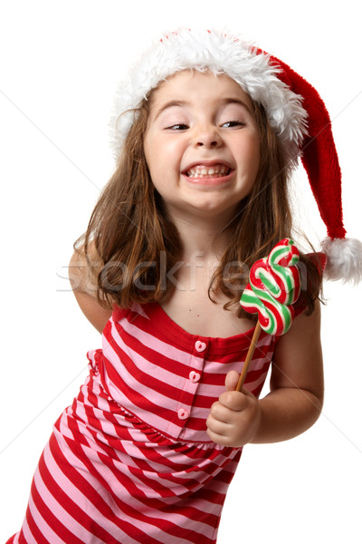 Christmas girl with cheeky smile Stock photo © lovleah
