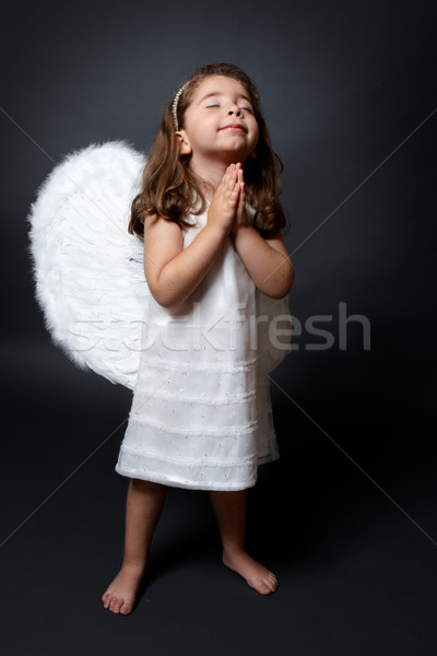 Praying angel with hands together in worship Stock photo © lovleah
