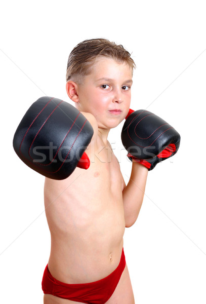 Boy boxer throwing a punch Stock photo © lovleah