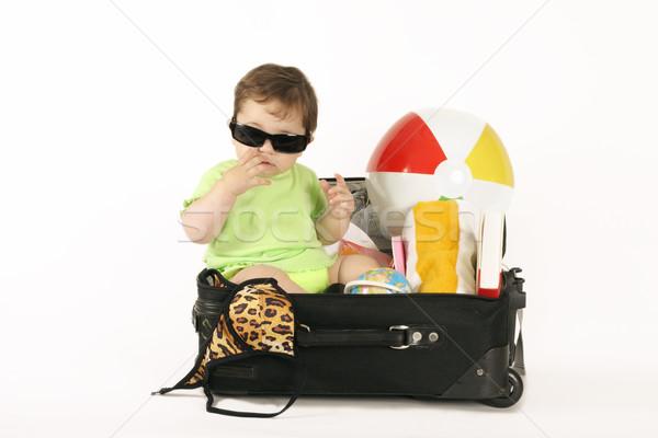 Tropical Getaway - baby in suitcase Stock photo © lovleah