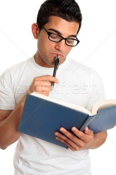 Férfi diák gondolkodik olvas tanul könyv Stock fotó © lovleah