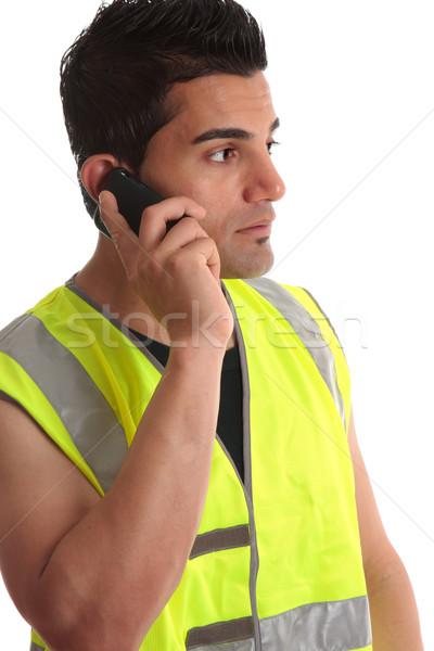 Tradesman on phone looking sideways Stock photo © lovleah