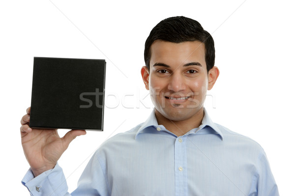 Salesman holding a product, book or other merchandise Stock photo © lovleah