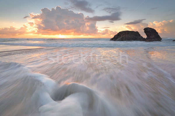 Sunrise océan roches étrange nuages Photo stock © lovleah