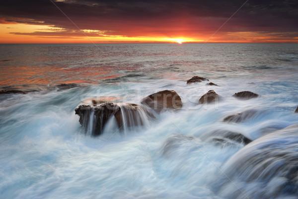 OceanwWaterfalls over rocks Stock photo © lovleah