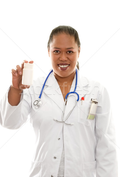 Female Ethnic Doctor with pharmaceuticals Stock photo © lovleah