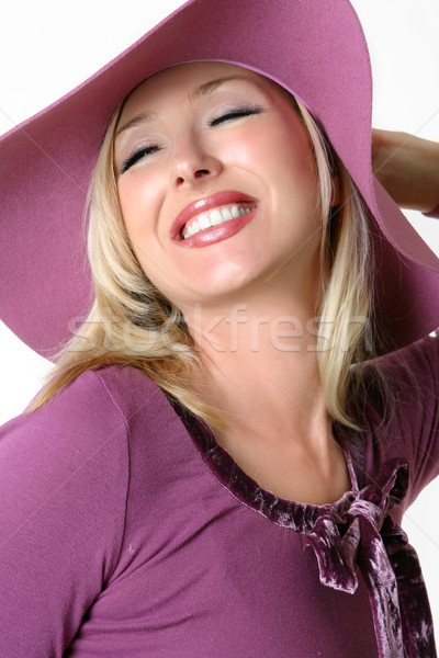 Vibrant happy young woman in a large brimmed hat Stock photo © lovleah