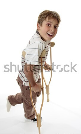 Injured child using crutches Stock photo © lovleah