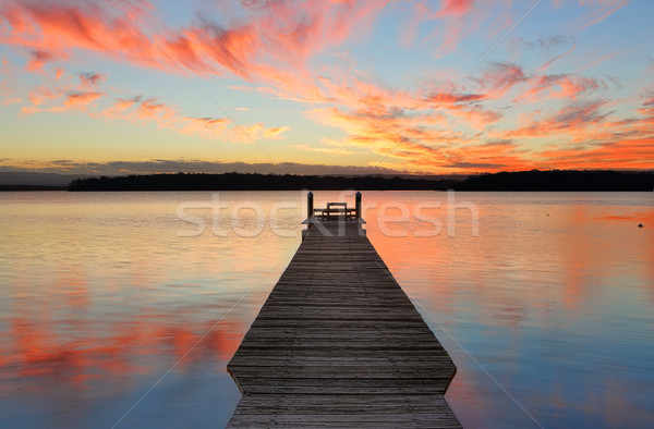 Sunset over St Georges Basin with timber jetty Stock photo © lovleah
