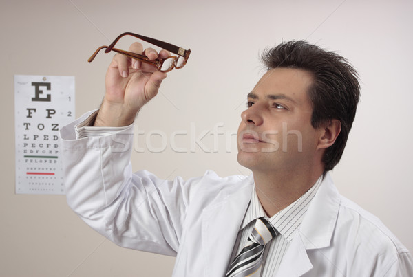 Optometrist inspecting eye glasses Stock photo © lovleah