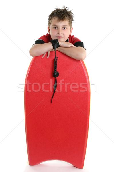 Gyermek pihen szörf tábla fehér sportok Stock fotó © lovleah