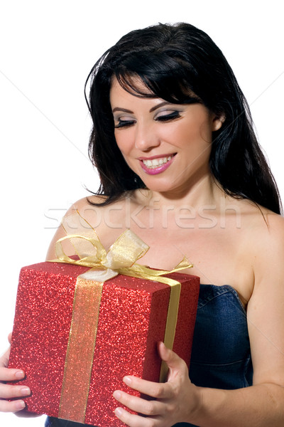 Woman holding a gift or present Stock photo © lovleah