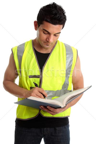 Bouwer schrijven boek bouwvakker witte werknemer Stockfoto © lovleah