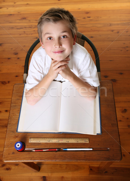 Child at desk with open book Stock photo © lovleah