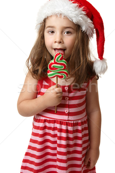 Santa girl licking Christmas tree lollipop candy Stock photo © lovleah
