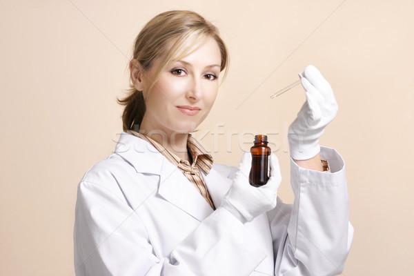 Homeopátia természetes gyógymódok nő tart kicsi üveg Stock fotó © lovleah
