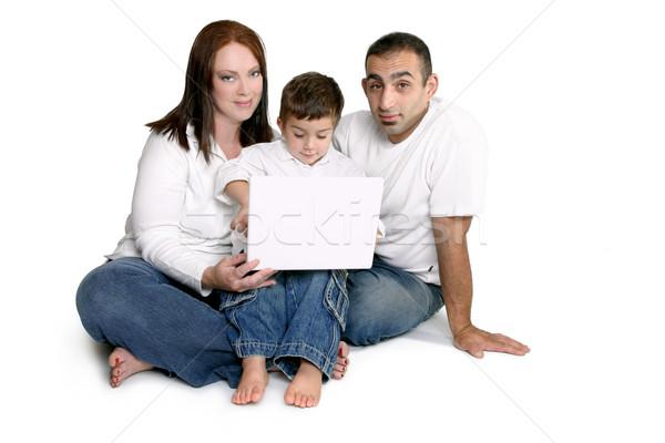 Család gyermek számítógép szülők ül együtt Stock fotó © lovleah