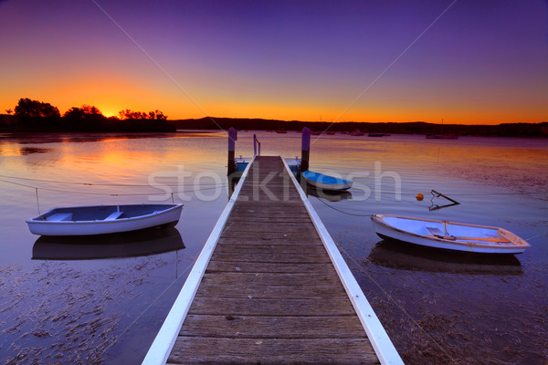 Sunset moorings and boat jetty in a little cove Australia Stock photo © lovleah