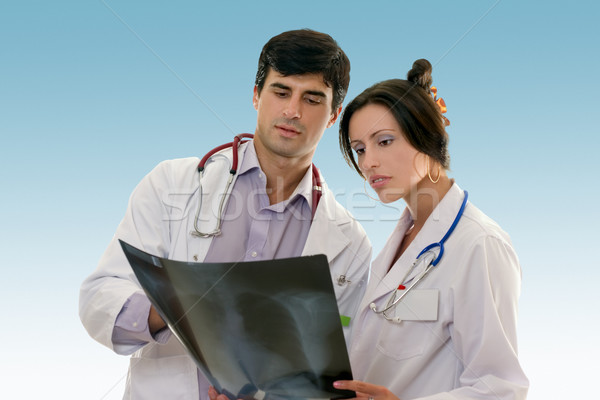 Two doctors conferring over x-ray results Stock photo © lovleah