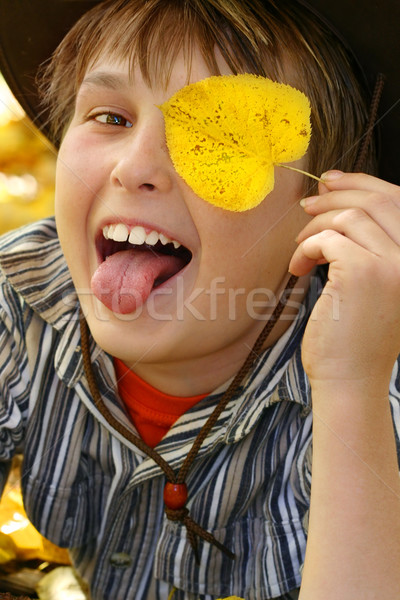 Happy fun boy playing with leaves in the autumn fall Stock photo © lovleah