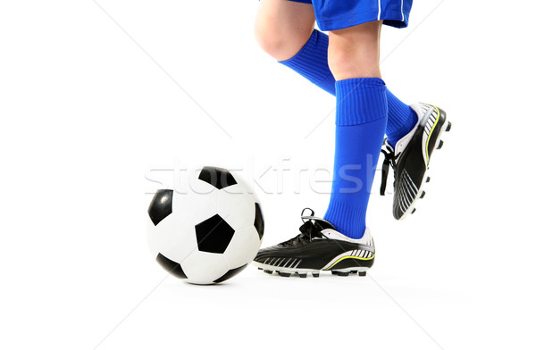 Boy kicking soccer ball Stock photo © lovleah