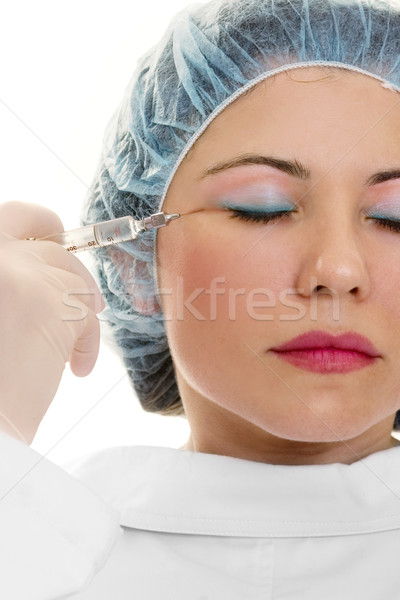 Woman receiving botox wrinkle treatment from doctor Stock photo © lovleah