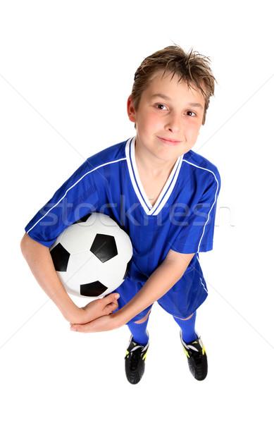 Fiú tart futballabda mosolyog futball egyenruha Stock fotó © lovleah