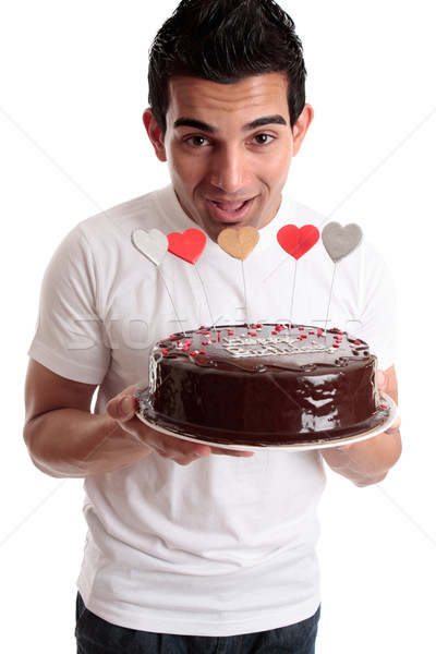 Cheeky man with a birthday cake Stock photo © lovleah