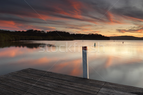 Amazing sunset colours and reflections from the timber jetty Stock photo © lovleah