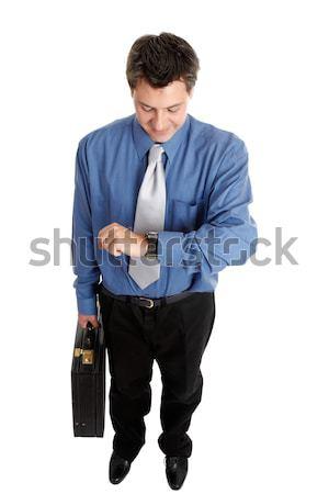 Geschäftsmann Zeit halten Aktentasche Executive Arbeitnehmer Stock foto © lovleah