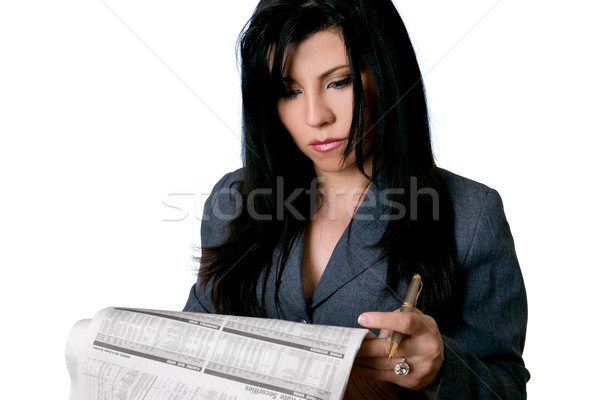Business woman holding a newspaper and pen Stock photo © lovleah